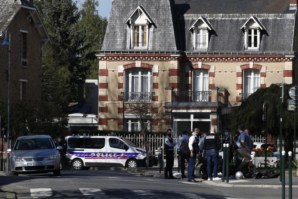 Police officers gather next to the Police station in Rambouillet, south west of Paris, Friday, April 23, 2021. A French police officer was stabbed to death inside her police station Friday near the famed historic Rambouillet chateau, and her attacker was shot and killed by officers at the scene, authorities said. The identity and the motive of the assailant were not immediately clear, a national police spokesperson told The Associated Press. The police officer was a 49-year-old administrative employee in the station, the spokesperson said. (AP Photo/Michel Euler)
