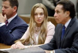 Lindsay Lohan, Mark Heller | Photo Credits: Reed Saxon - Pool/WireImage/Getty Images