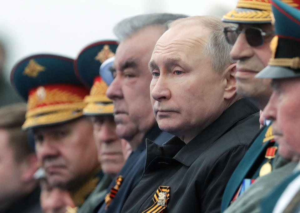 Russian President Vladimir Putin, center right, and Tajikistan's President Emomali Rakhmon, center left, watch the Victory Day military parade in Moscow, Russia, Sunday, May 9, 2021, marking the 76th anniversary of the end of World War II in Europe. (Mikhail Metzel, Sputnik, Kremlin Pool Photo via AP)