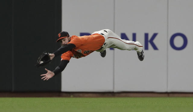 San Francisco Giants center fielder Steven Duggar catches a fly ball hit by Arizona Diamondbacks' Robbie Ray during the sixth inning of a baseball game in San Francisco, Friday, May 24, 2019. (AP Photo/Jeff Chiu)