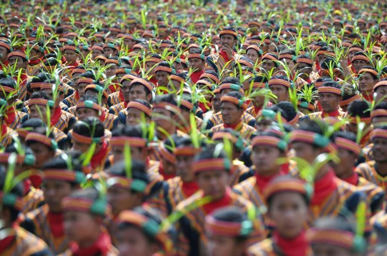 Participants take part in a mass traditional Saman dance performance in Aceh on Indonesia's Sumatra island on August 13, 2017