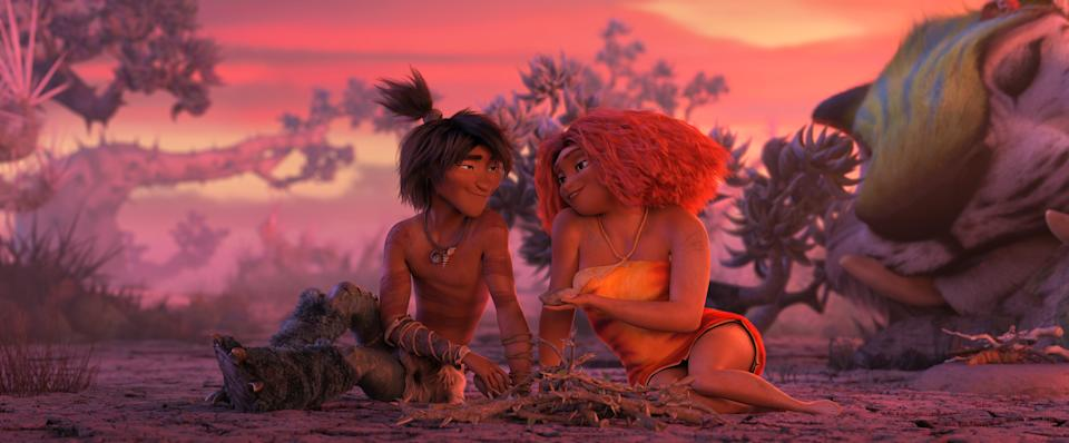 "Guy (Ryan Reynolds) and Eep Crood (Emma Stone) in a scene from ""The Croods: A New Age."""