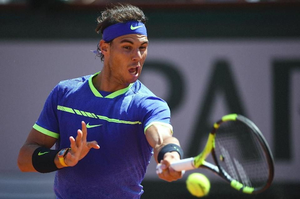 Spain's Rafael Nadal returns the ball to Switzerland's Stanislas Wawrinka during the men's final match at the Roland Garros 2017 French Open on June 11, 2017 in Paris (AFP Photo/Eric FEFERBERG)