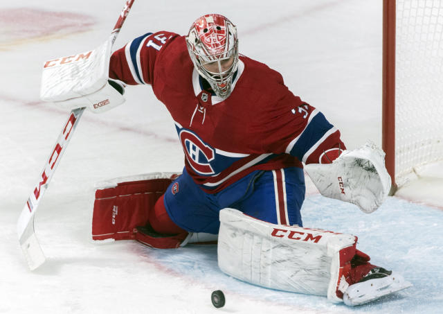 Montreal Canadiens goaltender Carey Price makes a save during the first period of an NHL hockey game against the Detroit Red Wings, Saturday, Dec. 14, 2019, in Montreal. (Graham Hughes/The Canadian Press via AP)