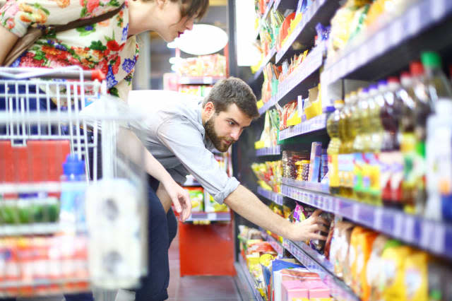 People shopping in supermarket.