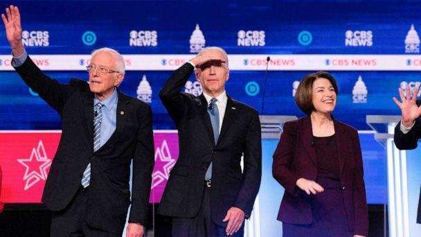 PHOTO: Democratic presidential hopefuls arrive on stage for the tenth Democratic primary debate at the Gaillard Center in Charleston, South Carolina, Feb. 25, 2020. (Jim Watson/AFP via Getty Images)