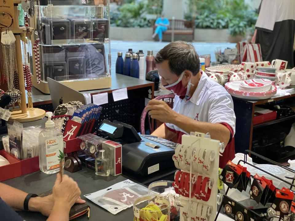 Andy Horn rings up a customer's purchase at High Tide Sports in the University Mall on Monday (Photo by Ryan Phillips, Tuscaloosa Patch)
