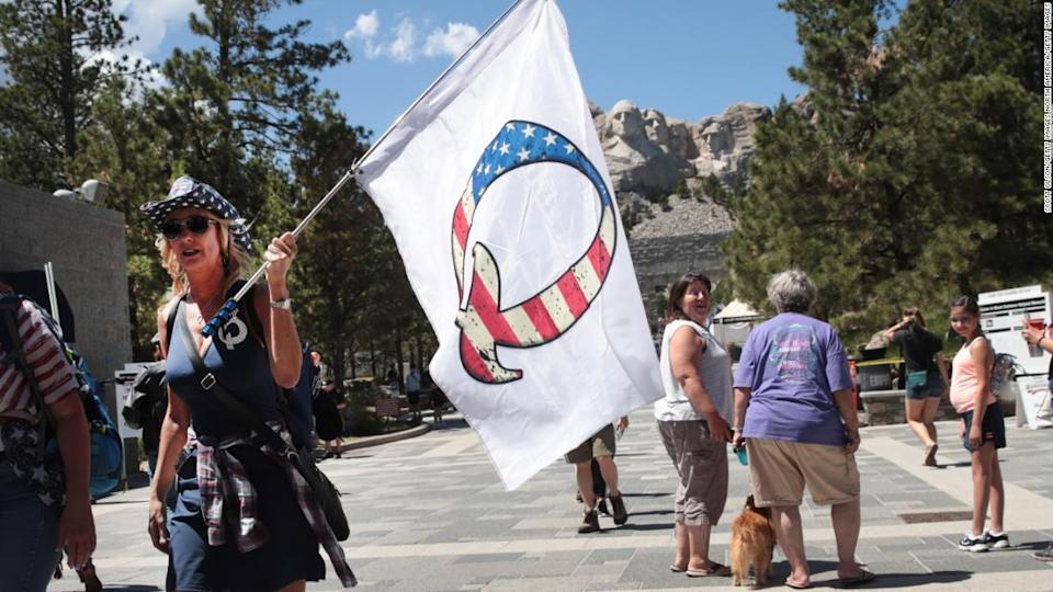 """<p>A QAnon supporter at Mount Rushmore National Monument on July 1, 2020 in Keystone, South Dakota. </p><div class=""""cnn--image__credit""""><em><small>Credit: Scott Olson/Getty Images North America/Getty Images / Getty Images</small></em></div>"""