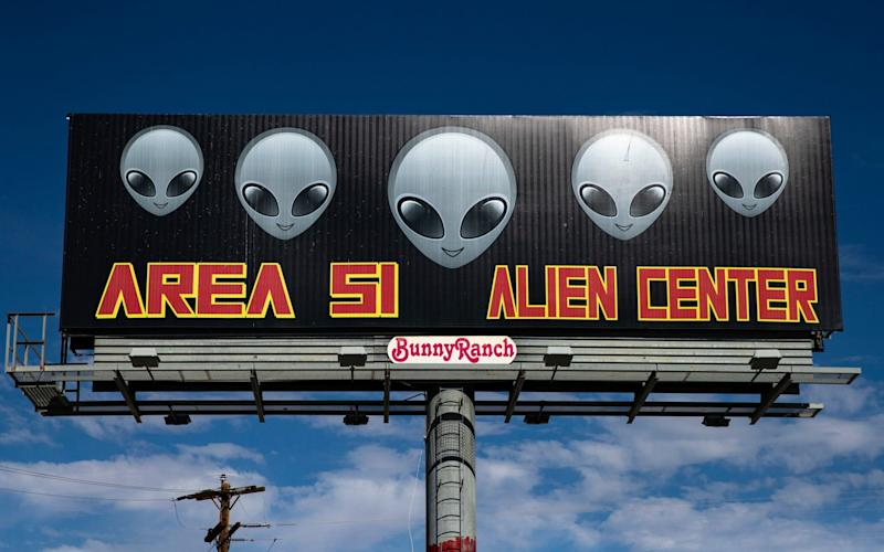 A sign reads 'Area 51 Alien Center' in front of the eponymous building, where more than 1,5 million people have decided to gather to 'storm' the Area 51 - REX