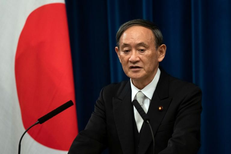 Japan PM Suga 'determined' to hold Olympics despite pandemic