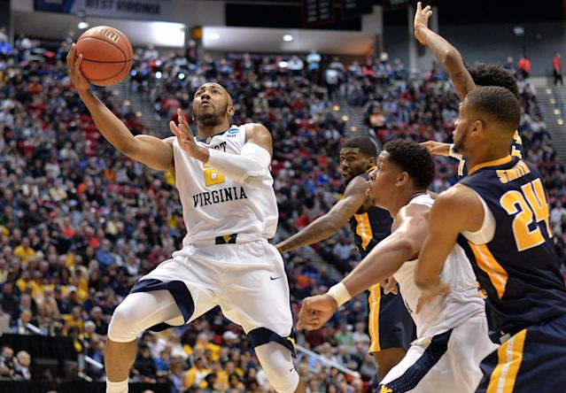 March 16, 2018; San Diego, CA, United States; West Virginia Mountaineers guard Jevon Carter (2) moves to the basket against Murray State Racers forward Anthony Smith (24) during the first half in the first round of the 2018 NCAA Tournament at Viejas Arena. Mandatory Credit: Jake Roth-USA TODAY Sports TPX IMAGES OF THE DAY