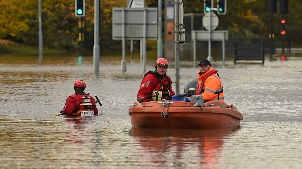 Rescuers used boats to reach people trapped in Rotherham as days of persistent rain led to almost 50 flood warnings across England in November 2019