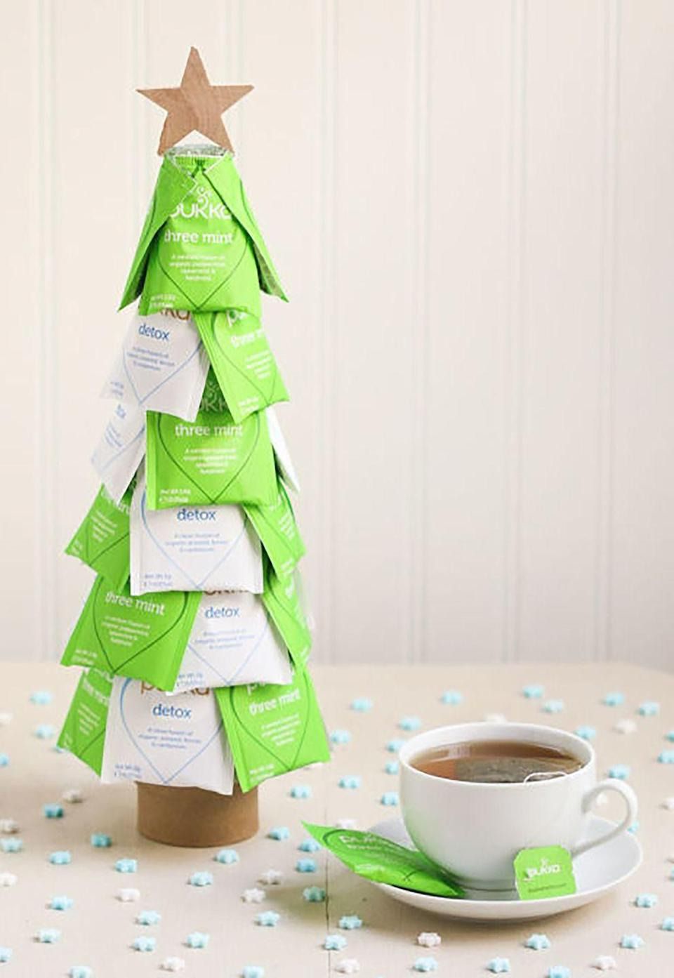 """<p>Arm yourself with a glue gun, some tea bags, and a styrofoam cone, and you've got yourself the perfect gift for the tea-lover in your life.</p><p><strong>Get the tutorial at <a href=""""http://www.thirstyfortea.com/2014/12/19/christmas-tea-trees/"""" rel=""""nofollow noopener"""" target=""""_blank"""" data-ylk=""""slk:Thirsty for Tea"""" class=""""link rapid-noclick-resp"""">Thirsty for Tea</a>.</strong></p><p><strong><a class=""""link rapid-noclick-resp"""" href=""""https://www.amazon.com/s/ref=nb_sb_noss_2?url=search-alias%3Daps&field-keywords=foam+cone&tag=syn-yahoo-20&ascsubtag=%5Bartid%7C10050.g.645%5Bsrc%7Cyahoo-us"""" rel=""""nofollow noopener"""" target=""""_blank"""" data-ylk=""""slk:SHOP FOAM CONE"""">SHOP FOAM CONE</a><br></strong></p>"""