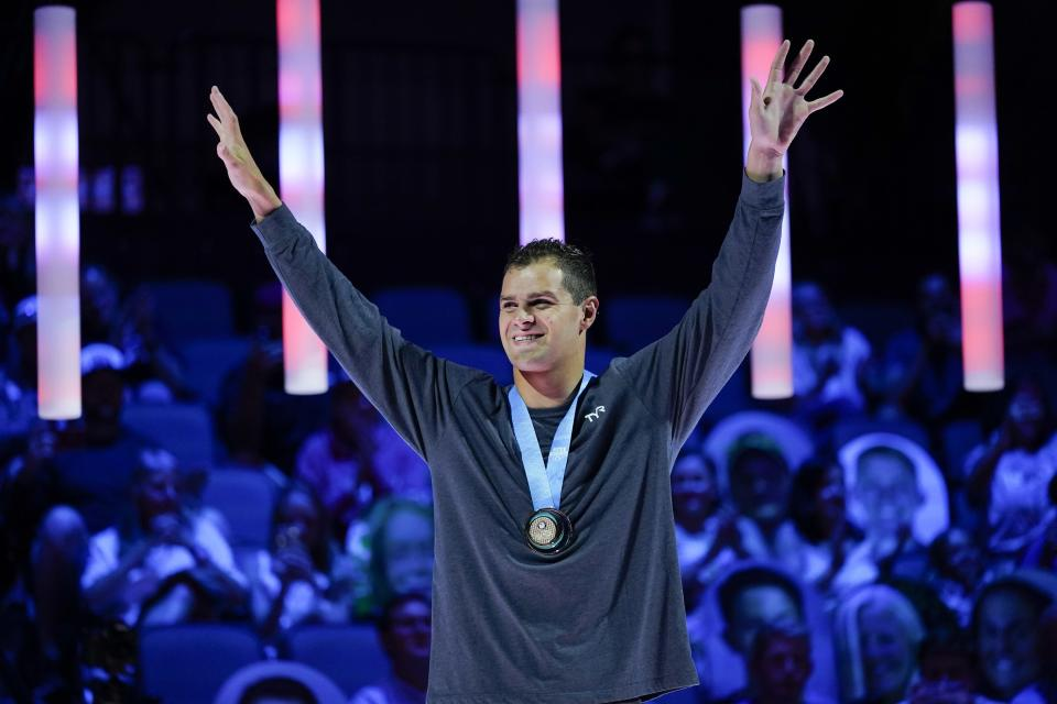 Michael Andrew reacts at the medal ceremony after winning the Men's 100 Breaststroke during wave 2 of the U.S. Olympic Swim Trials on Monday, June 14, 2021, in Omaha, Neb. (AP Photo/Charlie Neibergall)
