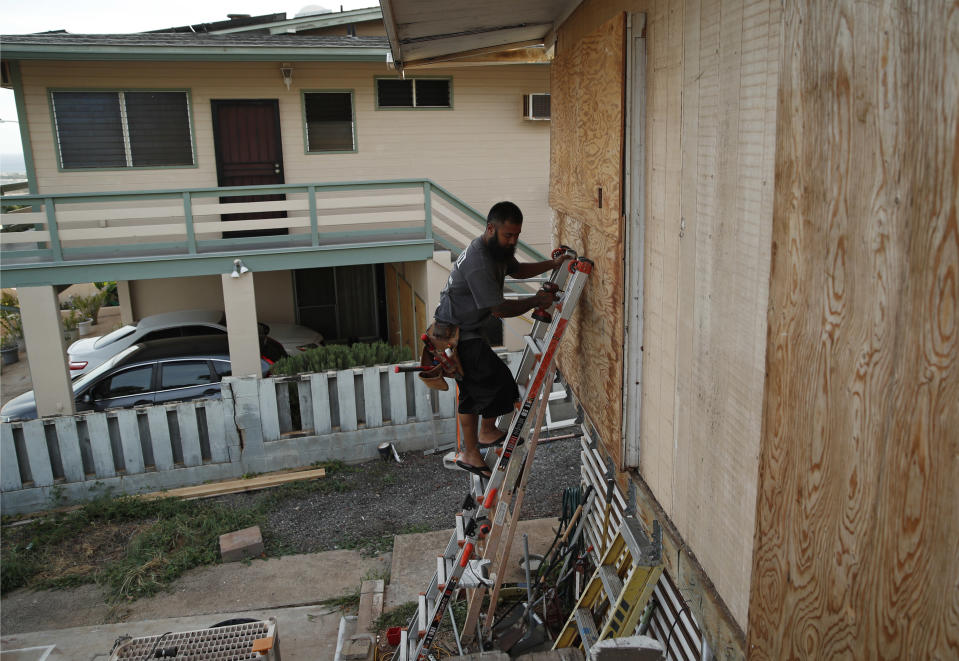 <p>Kaipo Popa secures plywood to protect windows on a home in preparation for Hurricane Lane, Wednesday, Aug. 22, 2018, in Kapolei, Hawaii. (Photo: John Locher/AP) </p>