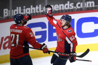 Washington Capitals left wing Carl Hagelin (62) celebrates his goal against the Philadelphia Flyers with right wing Garnet Hathaway (21) during the first period of an NHL hockey Tuesday, April 13, 2021, in Washington. (AP Photo/Nick Wass)
