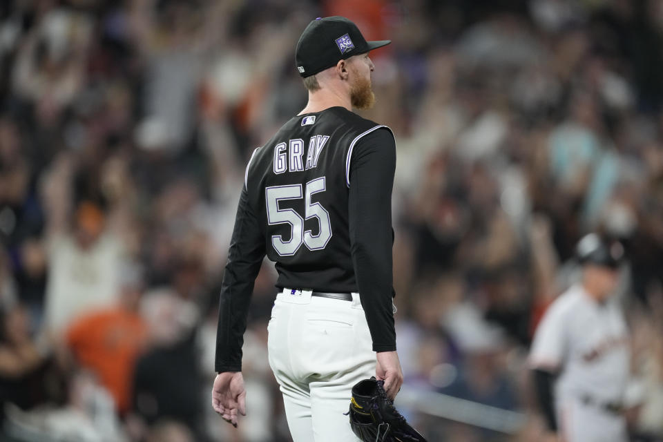 Colorado Rockies starting pitcher Jon Gray reacts after giving a three-run home run to San Francisco Giants' Brandon Belt in the fifth inning of a baseball game Saturday, Sept. 25, 2021, in Denver. (AP Photo/David Zalubowski)
