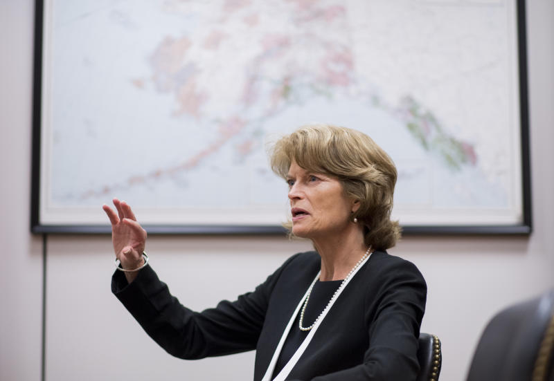 Sen. Lisa Murkowski's bill would open up an area of the Arctic wilderness to oil drilling in hopes of bringing in about $1 billion in federal revenue. (Bill Clark via Getty Images)