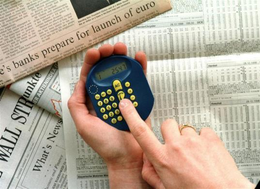 A 'euro calculator' is demonstrated in Bonn, December 29, 1998.