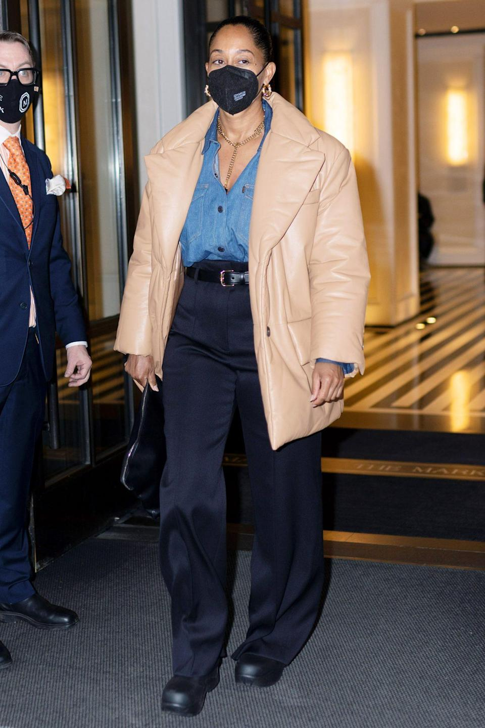 <p>Tracee Ellis Ross leaves her hotel in N.Y.C. on Thursday looking chic in black trousers, a denim blouse and leather jacket. </p>