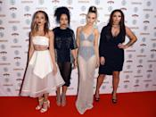 Little Mix donned an array of black and white ensembles and their signature dark lipstick. [Photo: Rex]