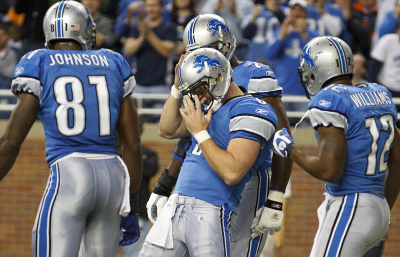 Detroit Lions quarterback Drew Stanton, center, celebrates his touchdown with Detroit Lions wide receiver Calvin Johnson (81) and Detroit Lions wide receiver Derrick Williams (12) in the first half of an NFL football game against the Chicago Bears in Detroit, Sunday, Dec. 5, 2010. (AP Photo/Rick Osentoski)