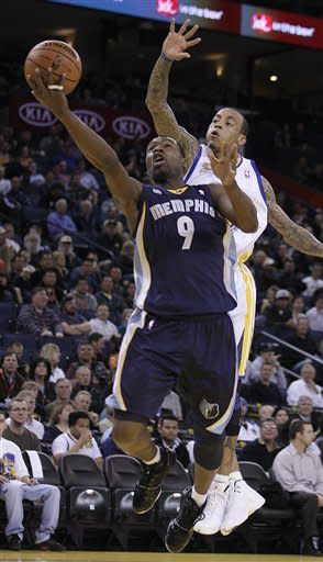 Memphis Grizzlies' Tony Allen (9) lays up a shot past Golden State Warriors' Monta Ellis during the first half of an NBA basketball game Wednesday, March 7, 2012, in Oakland, Calif. (AP Photo/Ben Margot)
