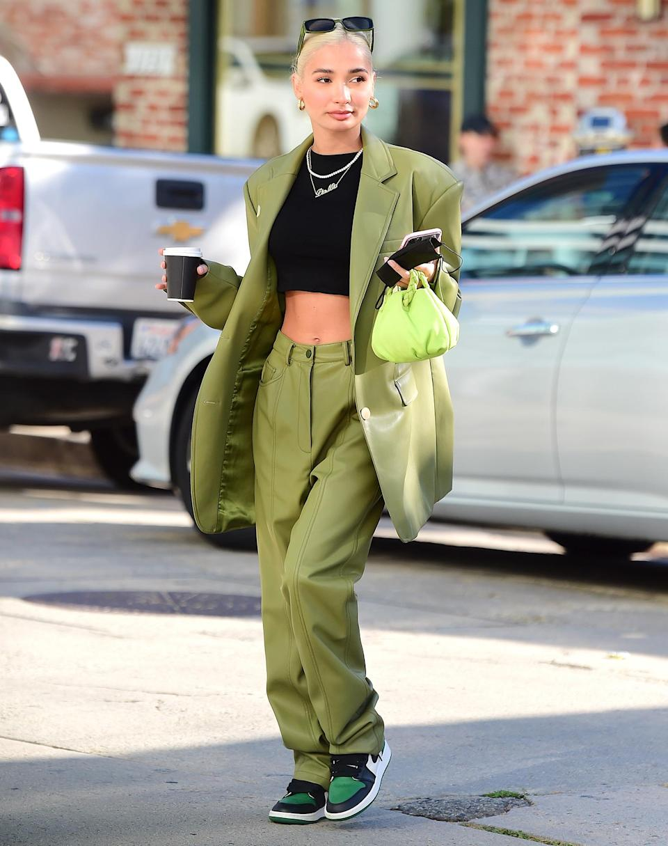 <p>Singer Pia Mia dons a green suit and black crop top for a coffee run in Westwood, California, on Monday.</p>