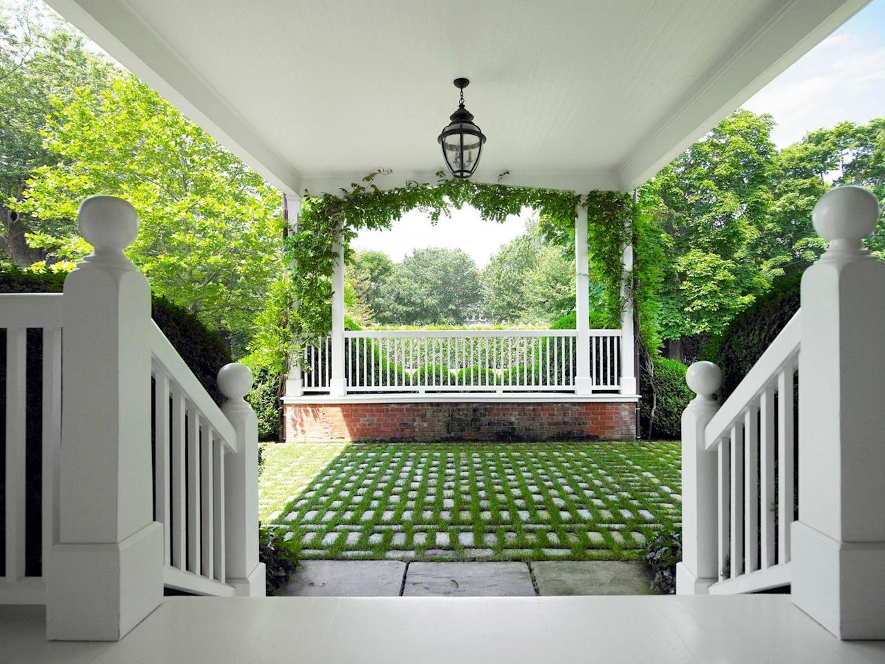 "<p><strong>The Style Guide: </strong>Concrete driveways love oil stains, so if you host a lot and love the look of green gardens, make your drive-up entry look like a valet-ready country club with permeable stone pavers. This beautiful driveway by <a href=""https://hollanderdesign.com/"" target=""_blank"">Hollander Design</a> is all the convincing we need. </p><p><strong>The Practical Need-to-Know:</strong> Permeable stone pavers are a drivable surface with stormwater drainage and, best of all, grassy green good looks. Because they're great for drainage, think about putting them wherever water tends to collect.</p>"