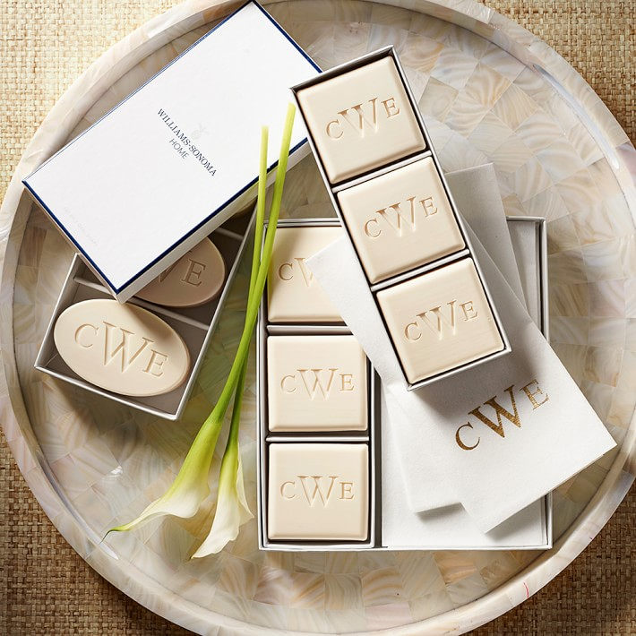 """<h3>Williams Sonoma Home Monogrammed Soaps</h3><br>Add a charming touch to these traditional triple-milled soaps using a single initial or a three-letter monogram.<br><br>Shop <a href=""""https://www.williams-sonoma.com"""" rel=""""nofollow noopener"""" target=""""_blank"""" data-ylk=""""slk:Williams Sonoma"""" class=""""link rapid-noclick-resp"""">Williams Sonoma</a><br><br><strong>Williams Sonoma Home</strong> Monogrammed Soap, $, available at <a href=""""https://go.skimresources.com/?id=30283X879131&url=https%3A%2F%2Fwww.williams-sonoma.com%2Fproducts%2Fwilliams-sonoma-home-monogrammed-soap-oval%2F"""" rel=""""nofollow noopener"""" target=""""_blank"""" data-ylk=""""slk:Williams Sonoma"""" class=""""link rapid-noclick-resp"""">Williams Sonoma</a>"""