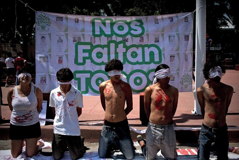 People protest against last year's disappearance and presumed slaughter of 43 college students during a demonstration against missing people in Guadalajara, Mexico, on July 26, 2015