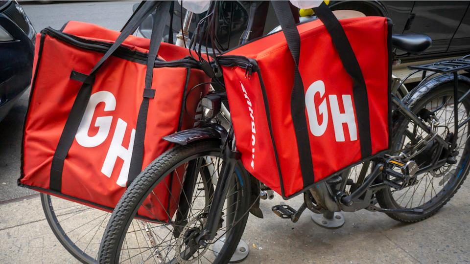 A delivery person's bicycle with GrubHub branded totes in the Chelsea neighborhood of New York