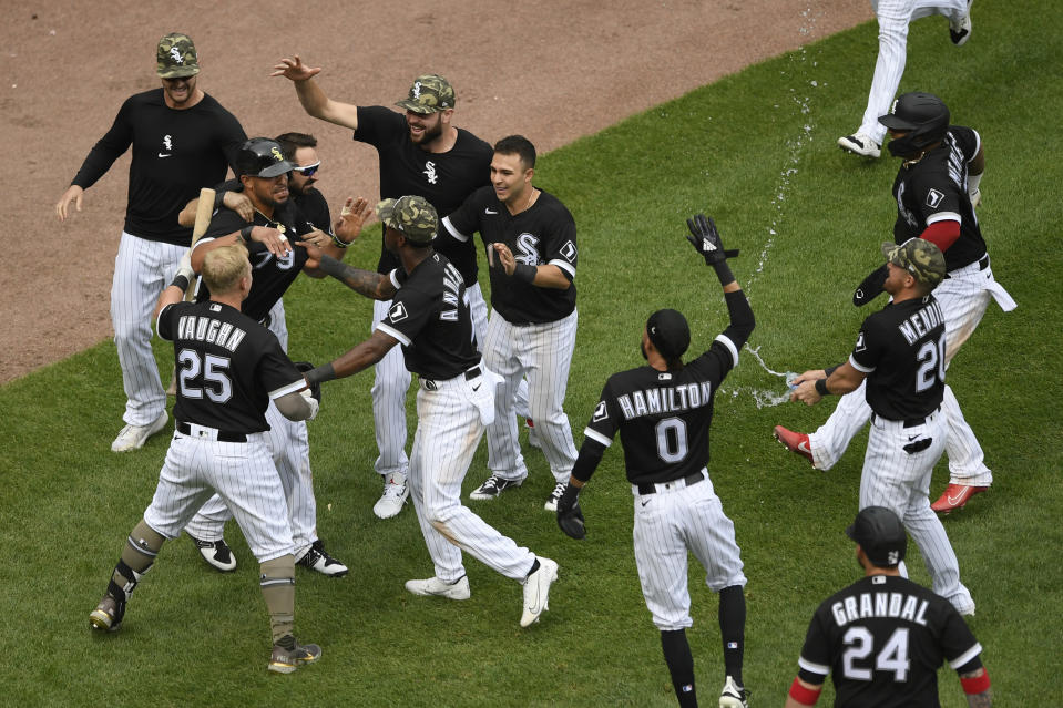 Chicago White Sox's Jose Abreu (79) celebrates with teammates after scoring on a wild pitch to defeat the Kansas City Royals during the ninth inning of a baseball game Sunday, May 16, 2021, in Chicago. (AP Photo/Paul Beaty)