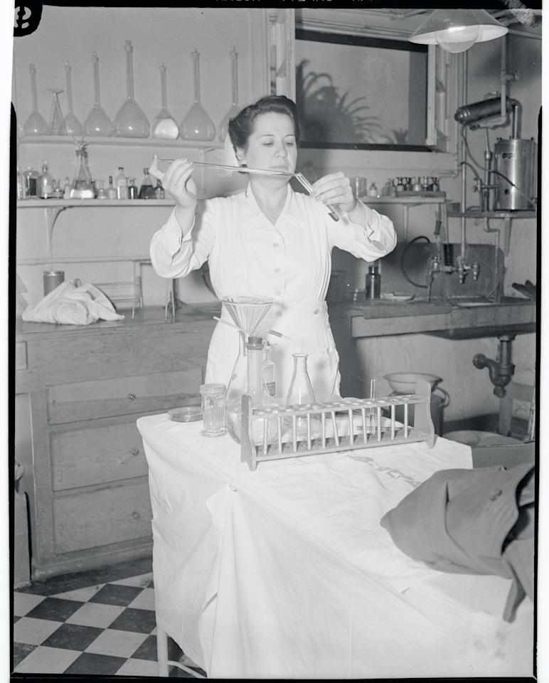<p>Nurse Dolores Hernandez, a registered Red Cross nurse who was inducted into the U.S. Army, works with medical equipment at Fort MacArthhur Laboratory in San Pedro, CA.</p>