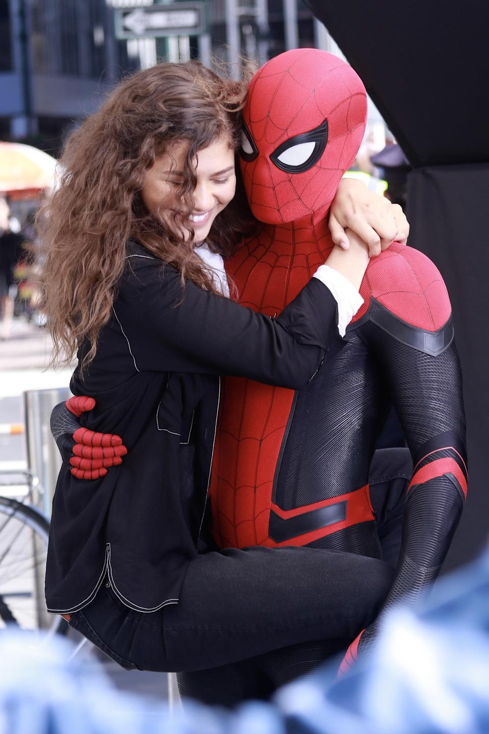 Previous MJ (Zendaya) and Spider-Man/Peter Parker (Tom) iterations (first, Kirsten Dunst and Tobey Maguire, and second, Andrew Garfield and Emma Stone) have had romantic relationships. So, naturally, people began speculating — was another romance afoot?