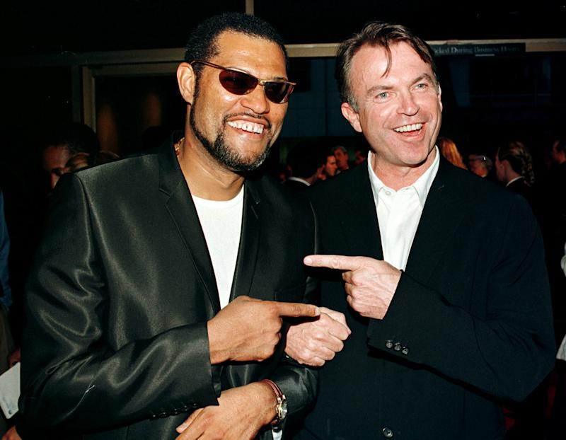 "Actors Laurence Fishburne (L) and Sam Neill pose together at the premiere of their new film ""Event Horizon"" August 12 in Beverly Hills. The science fiction film is about a rescue mission in the year 2047 sent to the outer reaches of the solar system to salvage a prototype spaceship missing for seven years. The film opens in the United States August 15."