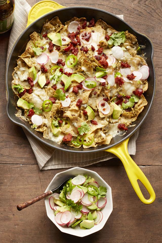 """<p>Crunchy tortilla chips, melted Monterey Jack cheese, and spicy chorizo are topped with jalapeños and fresh radishes in this traditional dish.</p><p><strong><a rel=""""nofollow"""" href=""""http://www.womansday.com/food-recipes/recipes/a57908/chorizo-chilaquiles-recipe/"""">Get the recipe.</a></strong></p>"""