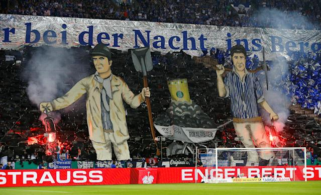 Soccer Football -DFB Cup - Schalke 04 vs Eintracht Frankfurt - Veltins-Arena, Gelsenkirchen, Germany - April 18, 2018 Schalke 04 fans display a banner before the match REUTERS/Wolfgang Rattay DFB RULES PROHIBIT USE IN MMS SERVICES VIA HANDHELD DEVICES UNTIL TWO HOURS AFTER A MATCH AND ANY USAGE ON INTERNET OR ONLINE MEDIA SIMULATING VIDEO FOOTAGE DURING THE MATCH.