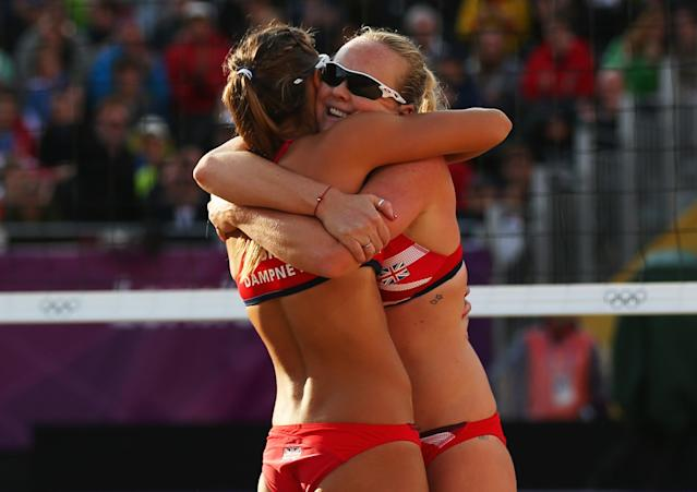 LONDON, ENGLAND - JULY 29: Zara Dampney and Shauna Mullin of Great Britain celebrate during the Women's Beach Volleyball Preliminary match between Great Britain and Canada on Day 2 of the London 2012 Olympic Games at Horse Guards Parade on July 29, 2012 in London, England. (Photo by Ryan Pierse/Getty Images)