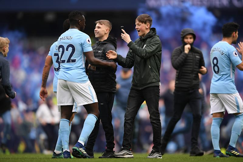 Manchester City won't face action for pitch invasion