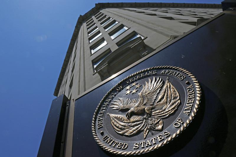 FILE - In this June 21, 2013, file photo, the seal affixed to the front of the Department of Veterans Affairs building in Washington. The Senate has approved legislation that would extend a program aimed at widening veterans' access to private-sector health care. The bill passed by voice vote. It would allow the Department of Veterans Affairs to continue operating its Choice program until its money runs out, expected early in 2018. (AP Photo/Charles Dharapak, File)