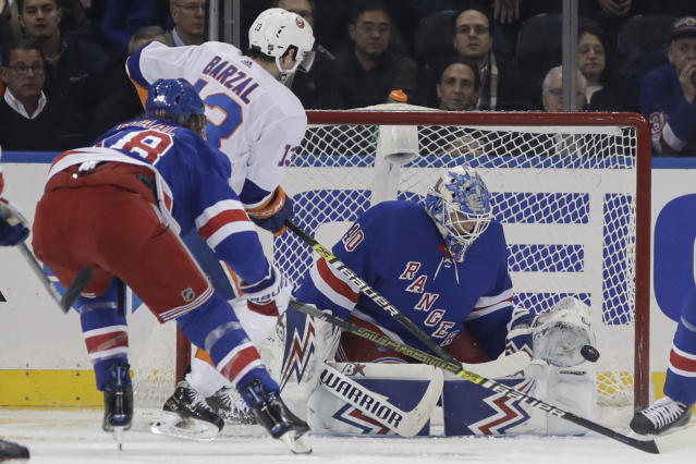 New York Rangers goaltender Alexandar Georgiev, right, stops a shot on goal by New York Islanders' Mathew Barzal during the second period of an NHL hockey game Tuesday, Jan. 21, 2020, in New York. (AP Photo/Frank Franklin II)