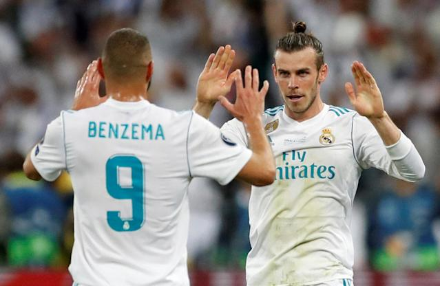 Soccer Football - Champions League Final - Real Madrid v Liverpool - NSC Olympic Stadium, Kiev, Ukraine - May 26, 2018 Real Madrid's Gareth Bale celebrates scoring their third goal with Karim Benzema REUTERS/Andrew Boyers