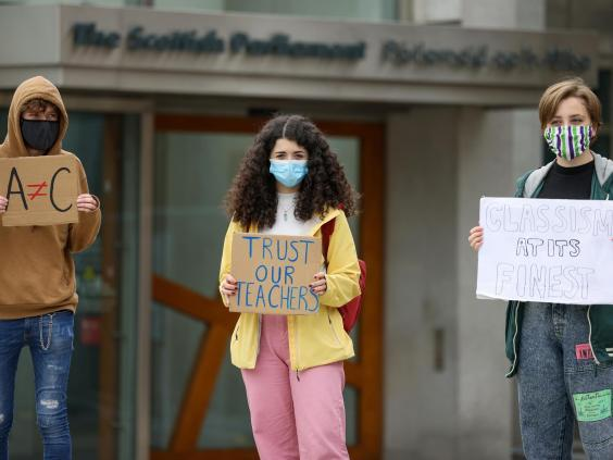 Pupils demonstrate outside the Scottish parliament over last week's downgrading of exam results by the Scottish Qualifications Authority (Getty)