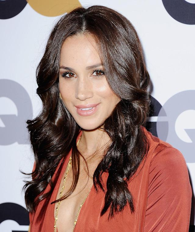 <p>At GQ's 2012 Men of the Year Party, the brunette beauty wore a very fitted dress and curly 'do. (Photo: Jon Kopaloff/FilmMagic) </p>