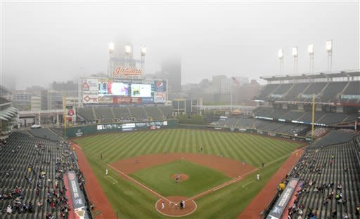 Fog and rain move in over Progressive Field as the Cleveland Indians and the Kansas City Royals face off in the fifth inning of a baseball game in Cleveland on Thursday, April 26, 2012. (AP Photo/Amy Sancetta)