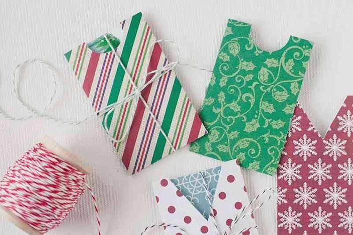"""<p>No need to use the branded sleeve in which your gift card was sold. Why not use wrapping paper scraps to DIY? <a href=""""http://www.anastasiamariecards.com/blog/diy-gift-card-holders/"""" rel=""""nofollow noopener"""" target=""""_blank"""" data-ylk=""""slk:Here's"""" class=""""link rapid-noclick-resp"""">Here's</a> a great tutorial. <i>(Photo: <a href=""""http://www.anastasiamariecards.com/blog/diy-gift-card-holders/"""" rel=""""nofollow noopener"""" target=""""_blank"""" data-ylk=""""slk:Anastasia Marie Cards"""" class=""""link rapid-noclick-resp"""">Anastasia Marie Cards</a>)</i></p>"""
