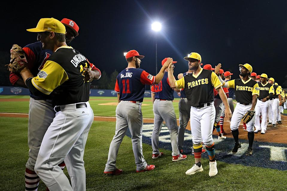 The Pirates and Cardinals shake hands following the inaugural MLB Little League Classic at BB&T Ballpark at Historic Bowman Field on August 20, 2017 in Williamsport, Pennsylvania. (Getty Images)