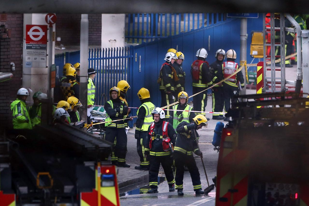 LONDON, UNITED KINGDOM - JANUARY 16:  Emergency services at the scene after a helicopter reportedly collided with a crane attached to St Georges Wharf Tower in Vauxhall, on January 16, 2013 in London, England. According to reports, the helicopter hit the crane before plunging into the road below during the morning rush hour.  (Photo by Dan Kitwood/Getty Images)
