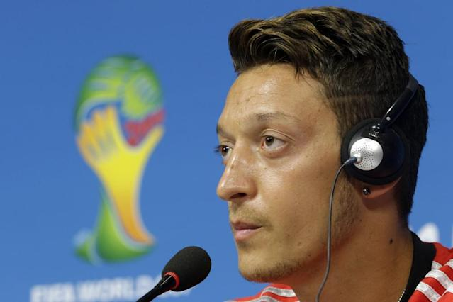 Germany's Mesut Ozil attends a press conference prior to a training session in Recife, Brazil, Wednesday, June 25, 2014. Germany will play the United States in group G of the 2014 soccer World Cup on June 26. (AP Photo/Julio Cortez)